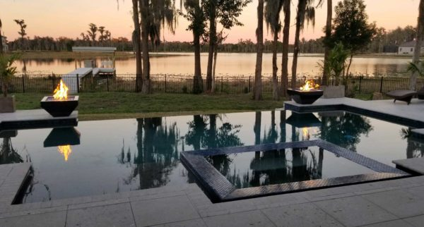 Pool fire bowls as sunset